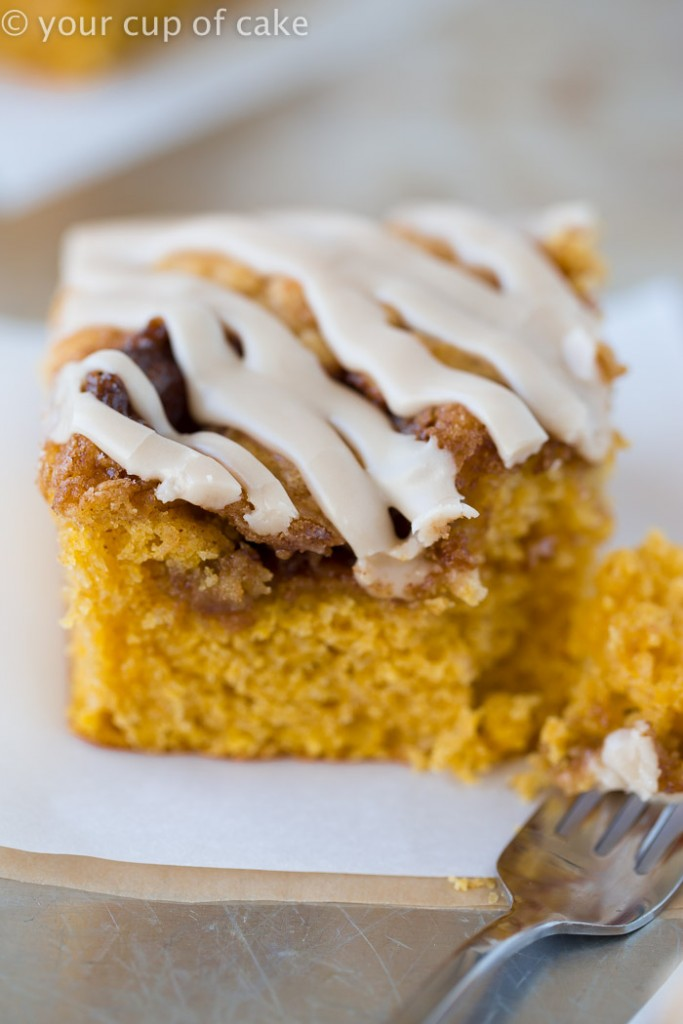 This Pumpkin Cinnamon Roll Cake is the most amazing cake ever! Serve it warm with the maple glaze!