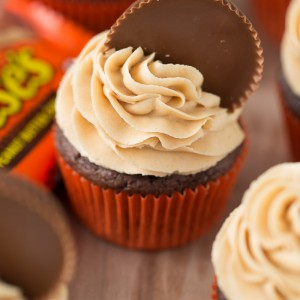 Reese's Peanut Butter Cupcakes with the fluffiest peanut butter frosting! Yum! Love this Recipe!