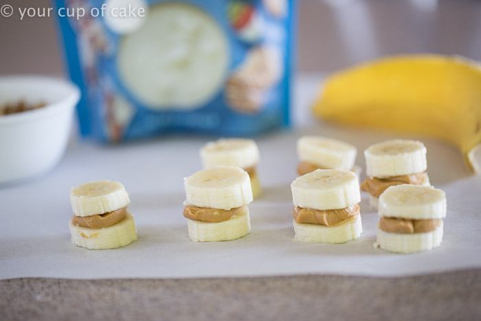 Banana Peanut Butter Bites dipped in white chocolate!  Eat them frozen for a perfect and healthy summer treat!