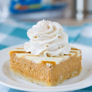 Pumpkin Pie Bars with a Cream Cheese Swirl and a no fuss crust! So easy and perfect for Thanksgiving!