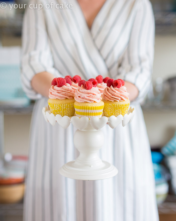 Raspberry Lemonade Cupcakes with a scratch and cake mix recipe! The raspberry frosting is to die for!