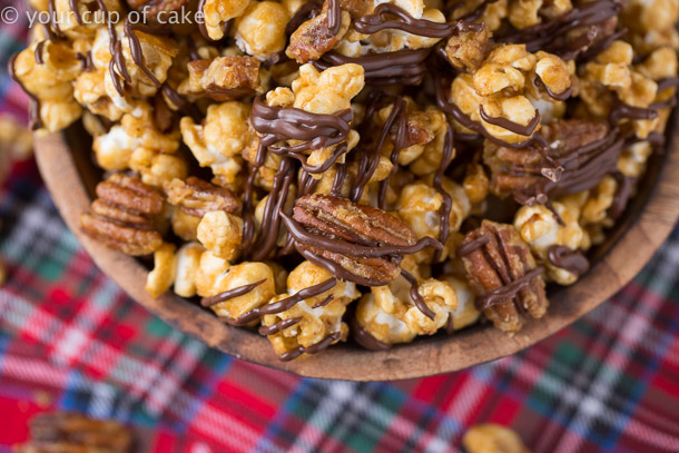 Turtle Caramel Corn with pecans and drizzled with milk chocolate for Christmas