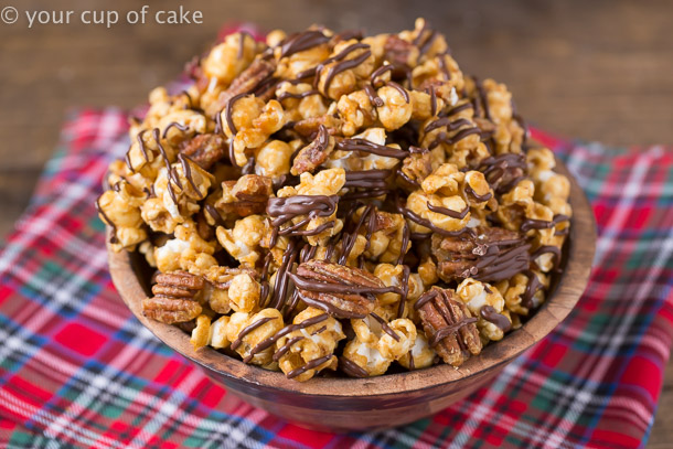 Turtle Caramel Corn Recipe with pecans and drizzled with milk chocolate!