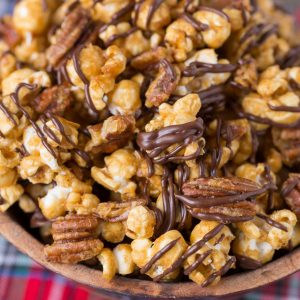 Turtle Caramel Corn with pecans and drizzled with milk chocolate!