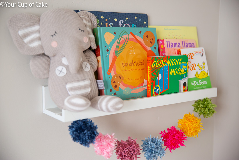Ikea Picture Ledges used as shelves in a nursery, so cute!
