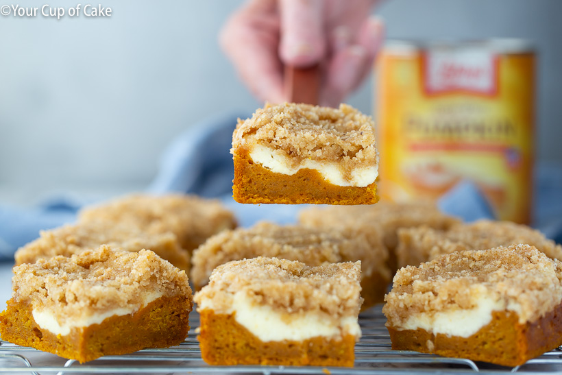 Pumpkin cake with a cream cheese swirl and streusel topping