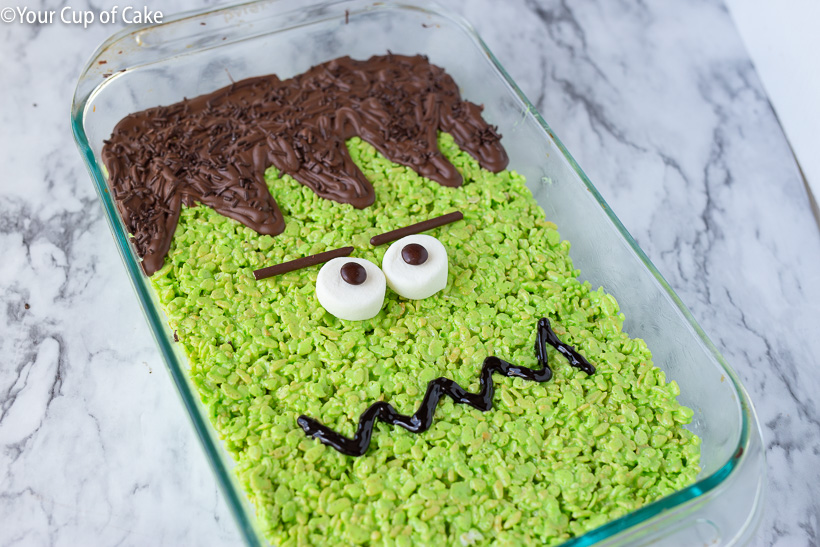 I LOVE this idea of making one HUGE Frankenstein RIce Krispie treat for halloween!